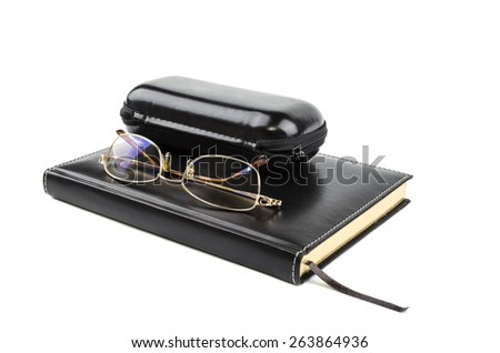 glasses on a notepad with Holster - stock photo