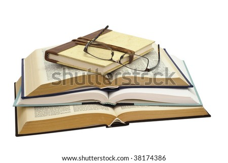 glasses on a stack of four books , one closed and three open, on white background, saved with clipping path - stock photo