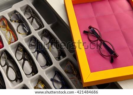 Glasses on a tray in an optical shop