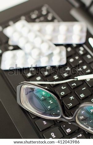 glasses on laptop keyboard