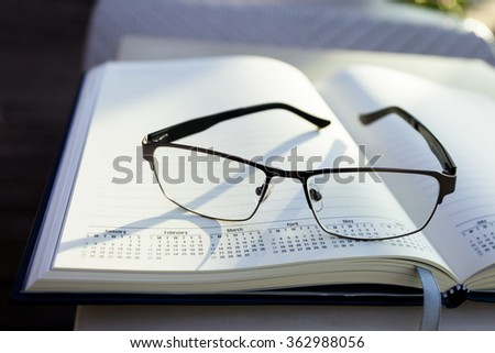 glasses on notepad