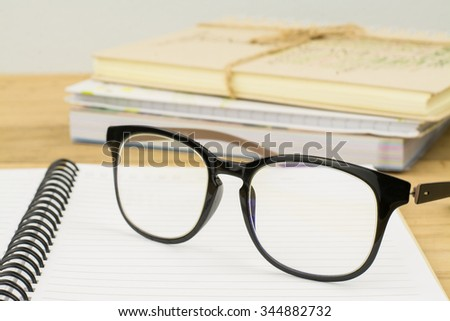 glasses on open empty diary,on table background