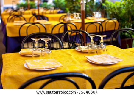 glasses on table - tables on the street, italian restaurant - Rome, Italy - stock photo