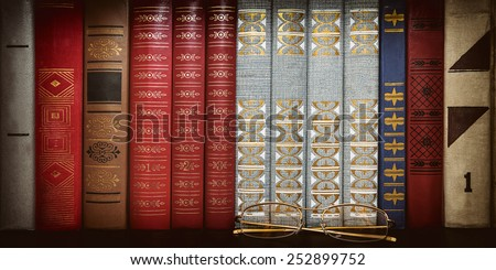 glasses on the background of books