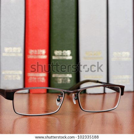 Glasses on the bookshelf