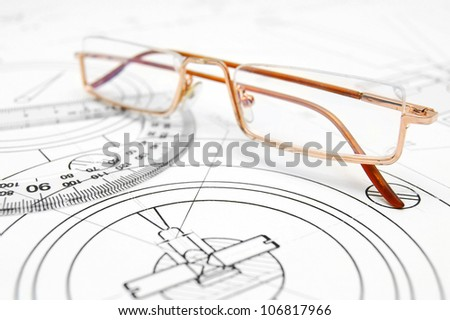 Glasses on the drawing . - stock photo