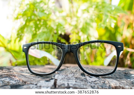 glasses on wood background