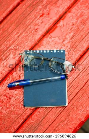 glasses pen notebook - stock photo