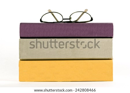 Glasses Sitting On Top Of Stacked Books Isolated On White - stock photo