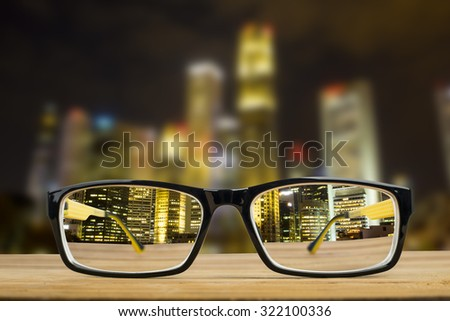 Glasses view vision focus viewpoint at Night City. - stock photo