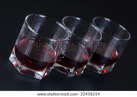 Glasses with a drink against a dark background
