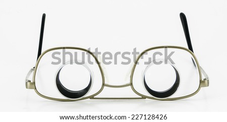 glasses with a loupe - stock photo