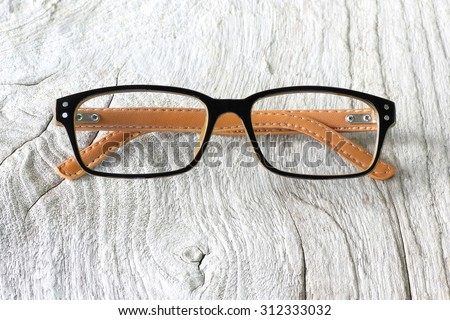 Glasses with Black Frame Fashion  on Wood Background - stock photo