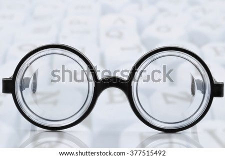 glasses with black frames on white background