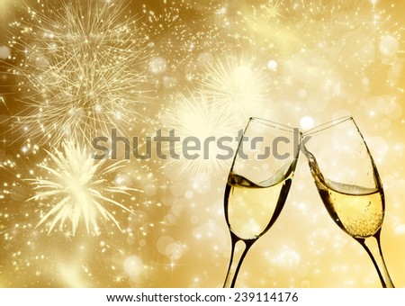 Glasses with champagne against fireworks and holiday lights - stock photo