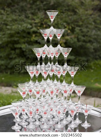glasses with champagne and cherries inside are in the form of a - stock photo