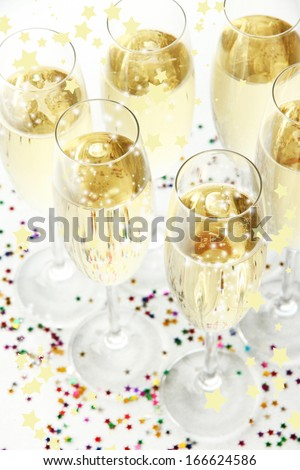 Glasses with champagne on shiny background - stock photo