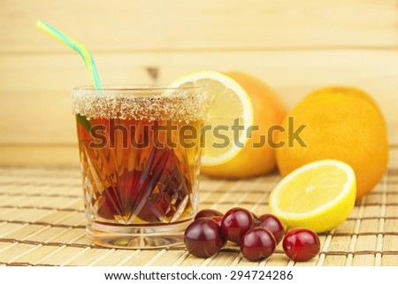 Glasses with cherries with rum. Preparing for summer refreshment cocktail. Cane rum and sugar. Sour pickled in rum. - stock photo