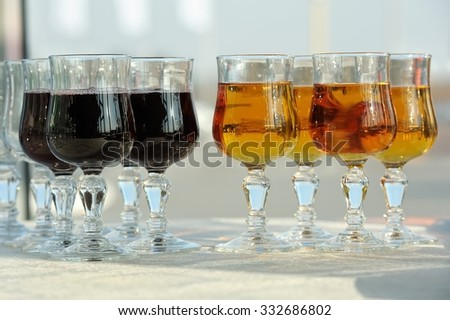 Glasses with cherry and grape juice