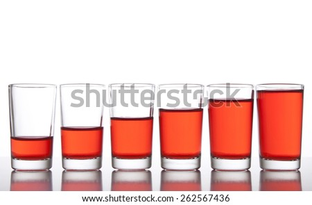 Glasses with different level of drink - stock photo