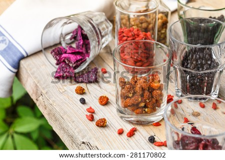 Glasses with dried superfruits - stock photo