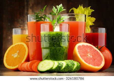 Glasses with fresh organic vegetable and fruit juices. Detox diet - stock photo