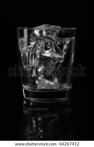 Glasses with ice on a black background - stock photo