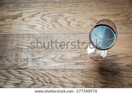 Glasses with red wine on the wooden background - stock photo