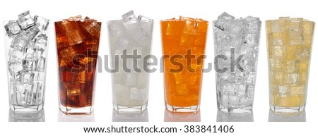 Glasses with sweet drinks with ice cubes isolated on white - stock photo