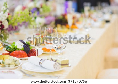glasses with water and champagne on food table