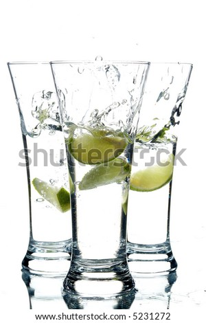 glasses with water and lime on the white background