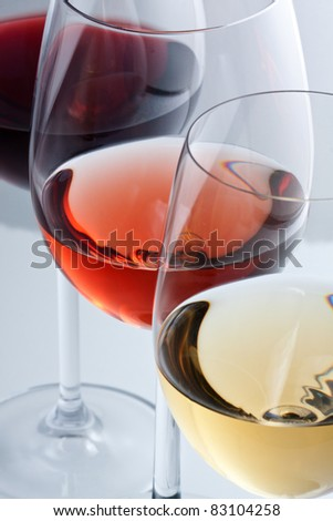 Glasses with white, rose and red wine. - stock photo