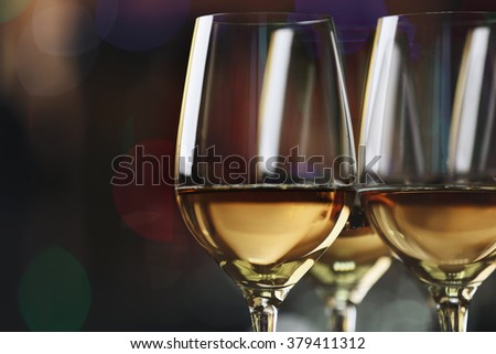 Glasses with white wine on blurred background - stock photo