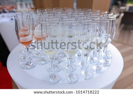 glasses with wine at white table