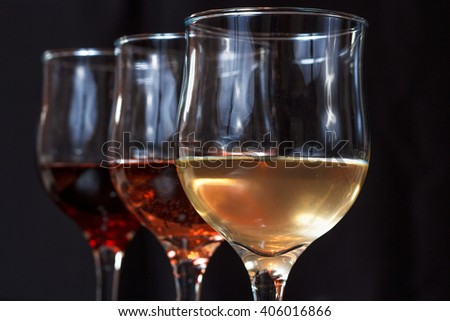 Glasses with wine, yellow, red, rose, close-up look - stock photo