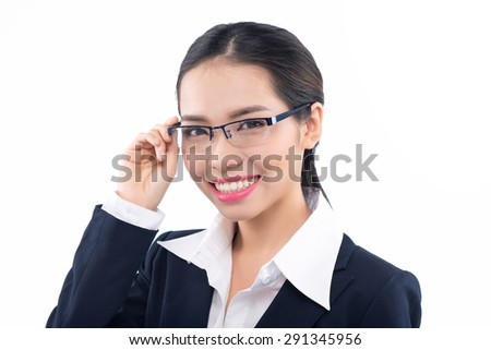 Glasses woman showing eyewear smiling happy holding glasses frame. Closeup of young asian caucasian woman smiling. White background. - stock photo
