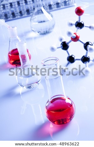 glassware in laboratory, flasks with fluids - stock photo