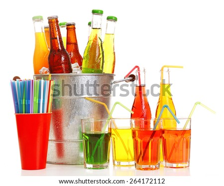 Glassware of different drinks in metal bucket isolated on white - stock photo