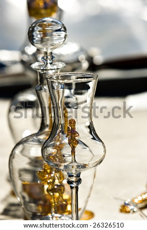 Glasswares. A decanter, a glass in the foreground. - stock photo