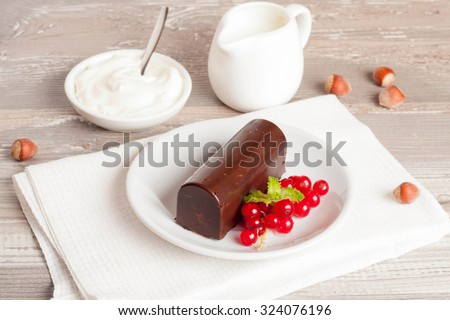 glazed cheese curds with chocolate and fresh currant . sweet breakfast. close-up.selective focus - stock photo