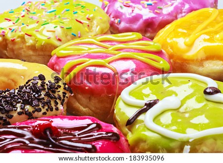 Glazed donuts in the range of background. Focus on middle frame - stock photo