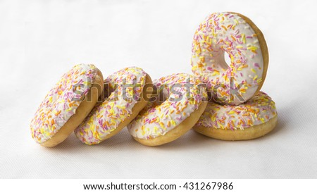 Glazed donuts on isolated background. The dessert of donuts for Breakfast. Nutritious dish that promotes obesity. Tasty food cakes. Delicious classic cakes: fried doughnuts glazed with caramel.  - stock photo