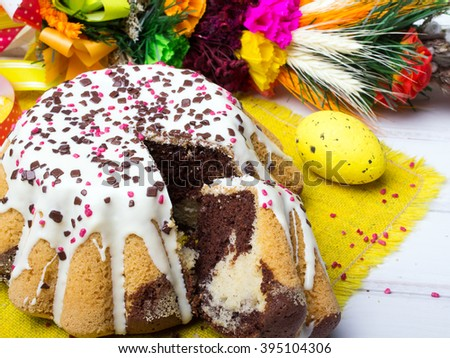 Glazed Easter cake with sprinkles and colorful eggs