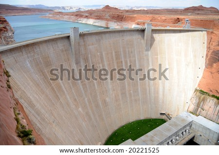 Glen Canyon Dam on the Colorado River near Page, Arizona, with Lake Powell in the background - stock photo