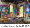 GLEN COVE, NY - MAY 10: Graffiti covered abandoned building on grounds of Pratt Mansion, Glen Cove NY on May 10, 2013. Former home of Harold Pratt the estate was once a Long Island Gold Coast Mansion - stock photo