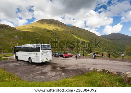 GLEN CROE, SCOTLAND - AUGUST 7, 2014: Tourists at Glen Croe, glen in the heart of Arrochar Alps.