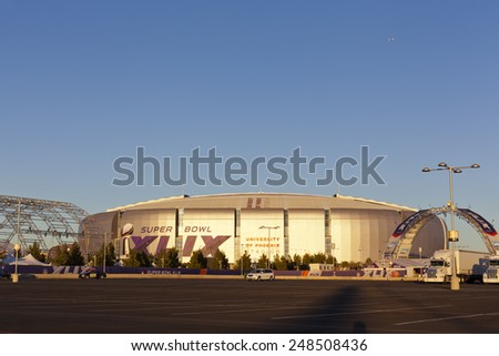 GLENDALE, AZ - JANUARY 24, 2015: Evening cast golden color on silver dome of University of Phoenix Arizona Cardinal Stadium that dressed up for Super Bowl XLIX taking place on  February 1, 2015 - stock photo