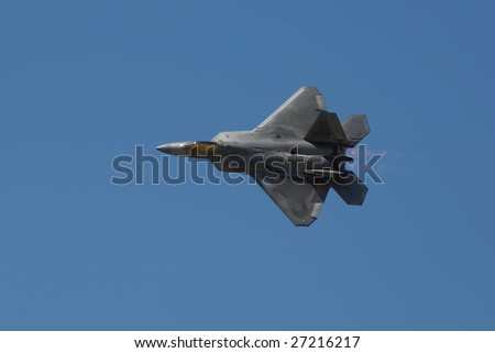 """GLENDALE, AZ - MARCH 21: A U.S. Air Force F-22 Raptor makes a knife edge pass at the biennial air show (""""Thunder in the Desert"""") at Luke Air Force Base on March 21, 2009 in Glendale, AZ. - stock photo"""