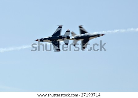 """GLENDALE, AZ - MARCH 21: The Air Force Thunderbirds perform a high speed pass at the biennial air show (""""Thunder in the Desert"""") at Luke Air Force Base on March 21, 2009 in Glendale, AZ. - stock photo"""