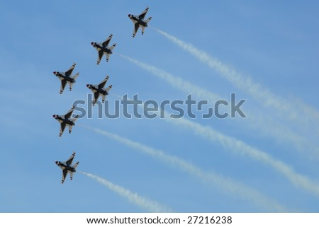 """GLENDALE, AZ - MARCH 21: The U.S. Air Force Thunderbirds fly in formation at the biennial air show (""""Thunder in the Desert"""") at Luke Air Force Base on March 21, 2009 in Glendale, AZ. - stock photo"""